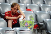 Bayern Muenchen fan looks dejected after the UEFA Champions League Final between FC Bayern Muenchen and Chelsea at the Fussball Arena München on May...