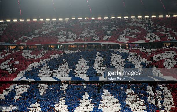 Bayern Muenchen fans display the team badge during the UEFA Champions League semifinal second leg match between FC Bayern Muenchen and Real Madrid at...