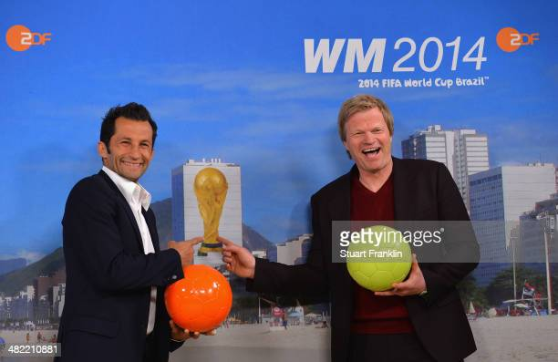 Bayern Muenchen football legends Hasan Salihamidzic and Oliver Kahn are pictured during the ARD/ZDF FIFA World Cup 2014 team presentation event on...