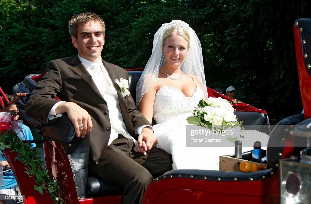 FC Bayern Muenchen football player Philipp Lahm and his wife Claudia Schattenberg leave their church wedding at the Sankt Emmerans church on July 14, 2010 in Kleinhelfendorf near Aying, Germany.