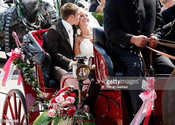 FC Bayern Muenchen football player Philipp Lahm and his wife Claudia Schattenberg leave their church wedding at the Sankt Emmerans church on July 14...