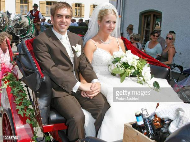 Bayern Muenchen football player Philipp Lahm and his wife Claudia Schattenberg leave their church wedding at the Sankt Emmerans church on July 14...