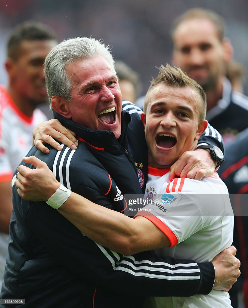FC Bayern Muenchen head coach <a gi-track='captionPersonalityLinkClicked' href=/galleries/search?phrase=Jupp+Heynckes&family=editorial&specificpeople=2062040 ng-click='$event.stopPropagation()'>Jupp Heynckes</a> celebrates with <a gi-track='captionPersonalityLinkClicked' href=/galleries/search?phrase=Xherdan+Shaqiri&family=editorial&specificpeople=6923918 ng-click='$event.stopPropagation()'>Xherdan Shaqiri</a> after winning the Bundesliga after the match between Eintracht Frankfurt and FC Bayern Muenchen at the Commerzbank-Arena on April 6, 2013 in Frankfurt am Main, Germany.