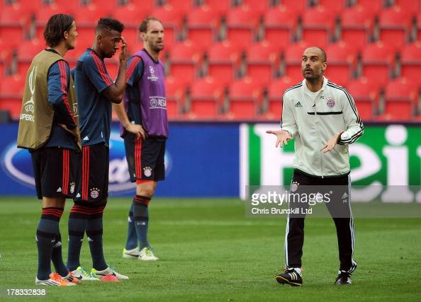 Bayern Muenchen manager Josep Guardiola makes a point during the Bayern Muenchen training session at Eden Stadium on August 29 2013 in Prague Czech...