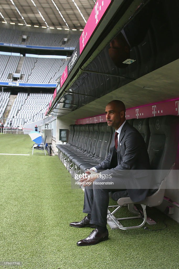 FC Bayern Muenchen new Head Coach <a gi-track='captionPersonalityLinkClicked' href=/galleries/search?phrase=Josep+Guardiola&family=editorial&specificpeople=2088964 ng-click='$event.stopPropagation()'>Josep Guardiola</a> sit on his coach seat at the Allianz Arena on the day he is unveiled as Bayern's new coach on June 24, 2013 in Munich, Germany.
