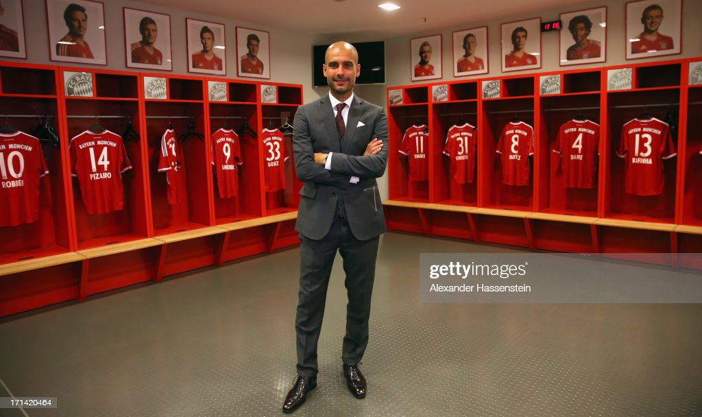 FC Bayern Muenchen new Head Coach <a gi-track='captionPersonalityLinkClicked' href=/galleries/search?phrase=Josep+Guardiola&family=editorial&specificpeople=2088964 ng-click='$event.stopPropagation()'>Josep Guardiola</a> visits the team locker room inside the Allianz Arena on the day he is unveiled as Bayern's new coach on June 24, 2013 in Munich, Germany.