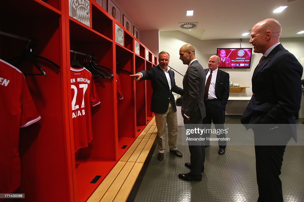 FC Bayern Muenchen new Head Coach <a gi-track='captionPersonalityLinkClicked' href=/galleries/search?phrase=Josep+Guardiola&family=editorial&specificpeople=2088964 ng-click='$event.stopPropagation()'>Josep Guardiola</a> (2nd L) visits with <a gi-track='captionPersonalityLinkClicked' href=/galleries/search?phrase=Karl-Heinz+Rummenigge&family=editorial&specificpeople=634867 ng-click='$event.stopPropagation()'>Karl-Heinz Rummenigge</a> (L), CEO of Bayern Muenchen, <a gi-track='captionPersonalityLinkClicked' href=/galleries/search?phrase=Uli+Hoeness&family=editorial&specificpeople=634868 ng-click='$event.stopPropagation()'>Uli Hoeness</a> (2nd R), President of Bayern Muenchen and <a gi-track='captionPersonalityLinkClicked' href=/galleries/search?phrase=Matthias+Sammer&family=editorial&specificpeople=555228 ng-click='$event.stopPropagation()'>Matthias Sammer</a> (R), Sporting Director of Bayern Muenchen the team locker room inside the Allianz Arena on the day he is unveiled as Bayern's new coach on June 24, 2013 in Munich, Germany.