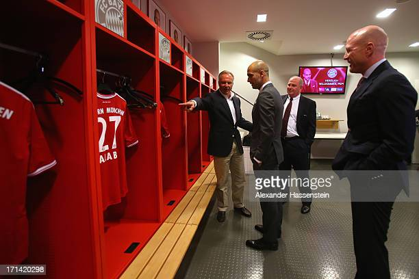 Bayern Muenchen new Head Coach Josep Guardiola visits with KarlHeinz Rummenigge CEO of Bayern Muenchen Uli Hoeness President of Bayern Muenchen and...