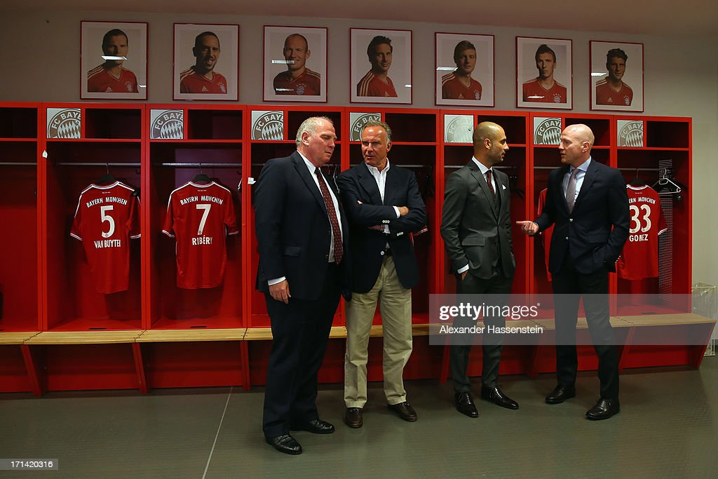 FC Bayern Muenchen new Head Coach <a gi-track='captionPersonalityLinkClicked' href=/galleries/search?phrase=Josep+Guardiola&family=editorial&specificpeople=2088964 ng-click='$event.stopPropagation()'>Josep Guardiola</a> (2nd R) visits with <a gi-track='captionPersonalityLinkClicked' href=/galleries/search?phrase=Karl-Heinz+Rummenigge&family=editorial&specificpeople=634867 ng-click='$event.stopPropagation()'>Karl-Heinz Rummenigge</a> (2nd L), CEO of Bayern Muenchen, <a gi-track='captionPersonalityLinkClicked' href=/galleries/search?phrase=Uli+Hoeness&family=editorial&specificpeople=634868 ng-click='$event.stopPropagation()'>Uli Hoeness</a> (2nd L), President of Bayern Muenchen and <a gi-track='captionPersonalityLinkClicked' href=/galleries/search?phrase=Matthias+Sammer&family=editorial&specificpeople=555228 ng-click='$event.stopPropagation()'>Matthias Sammer</a> (R), Sporting Director of Bayern Muenchen the team locker room inside the Allianz Arena on the day he is unveiled as Bayern's new coach on June 24, 2013 in Munich, Germany.