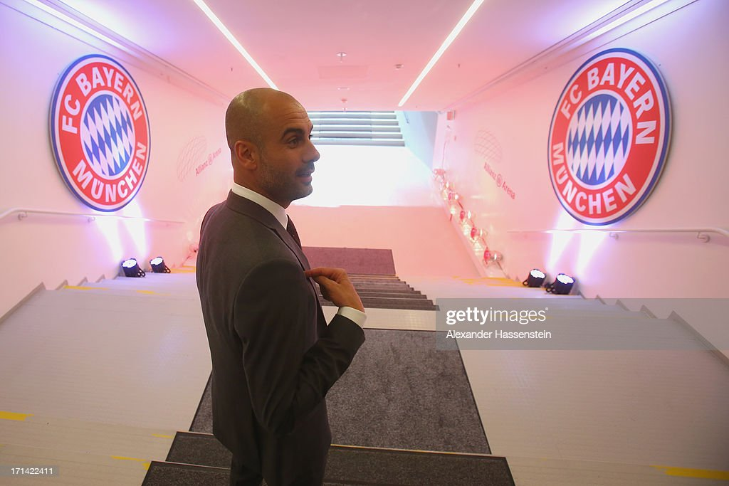 FC Bayern Muenchen new Head Coach <a gi-track='captionPersonalityLinkClicked' href=/galleries/search?phrase=Josep+Guardiola&family=editorial&specificpeople=2088964 ng-click='$event.stopPropagation()'>Josep Guardiola</a> walks at the players tunnel to the pitch inside the Allianz Arena on the day he is unveiled as Bayern's new coach on June 24, 2013 in Munich, Germany.
