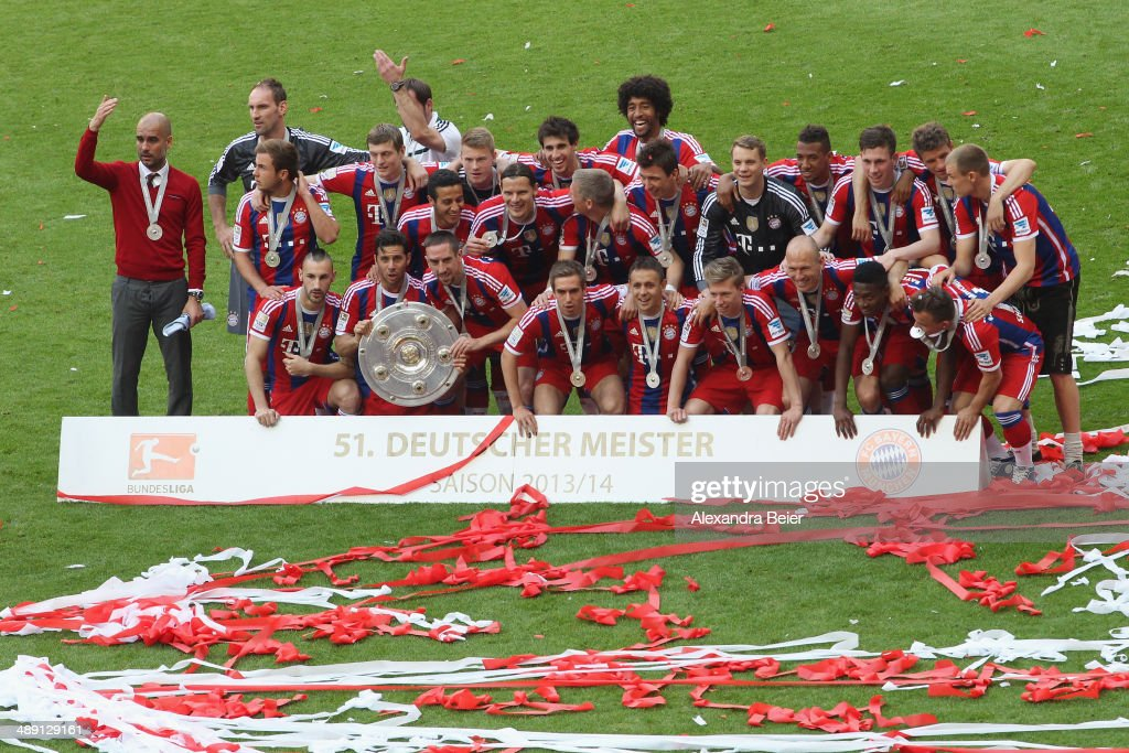 Bayern Muenchen player celebrate with the Bundesliga championship trophy after the Bundesliga match between FC Bayern Muenchen and VfB Stuttgart at Allianz Arena on May 10, 2014 in Munich, Germany.