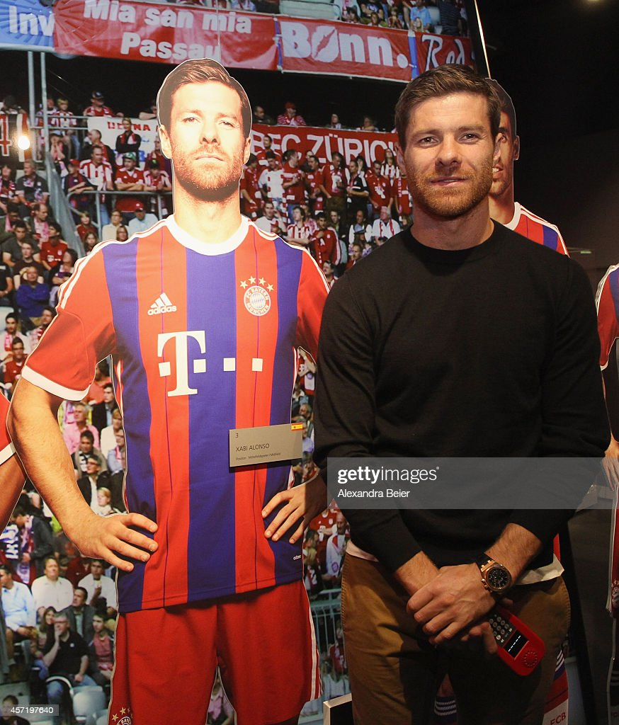 FC Bayern Muenchen player Xabi Alonso stands next to a model of himself during his visit at the FC Bayern Erlebniswelt museum at Allianz Arena on October 14, 2014 in Munich, Germany.