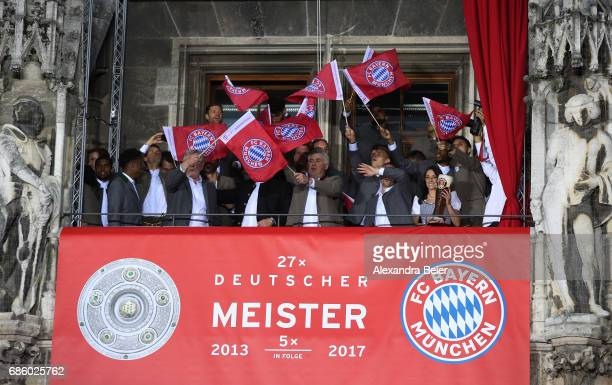 Bayern Muenchen players and staff celebrate winning the 67th German Championship title on the town hall balcony at Marienplatz on May 20 2017 in...
