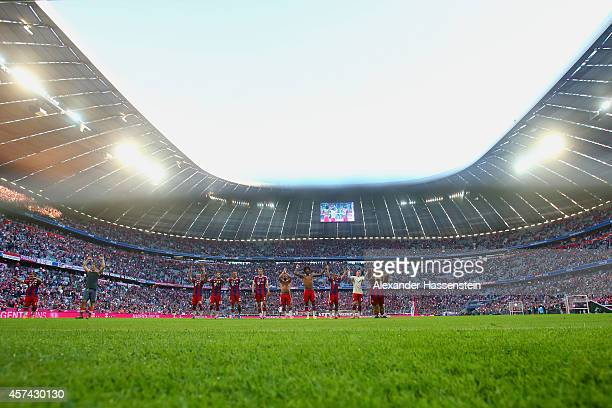 Bayern Muenchen players celebrate 60 in front of fans during the Bundesliga match between FC Bayern Muenchen and SV Werder Bremen at Allianz Arena on...