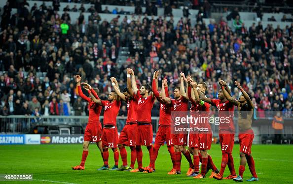 Bayern Muenchen players celebrate in front of their fans following victory during the UEFA Champions League Group F match between FC Bayern Muenchen...