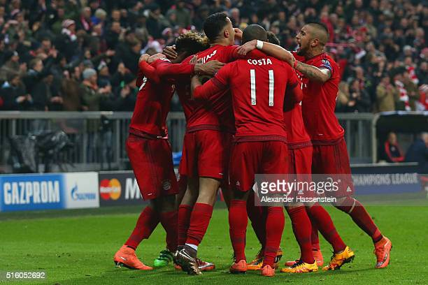 Bayern Muenchen players celebrate their fourth goal by Kingsley Coman during the UEFA Champions League round of 16 second Leg match between FC Bayern...