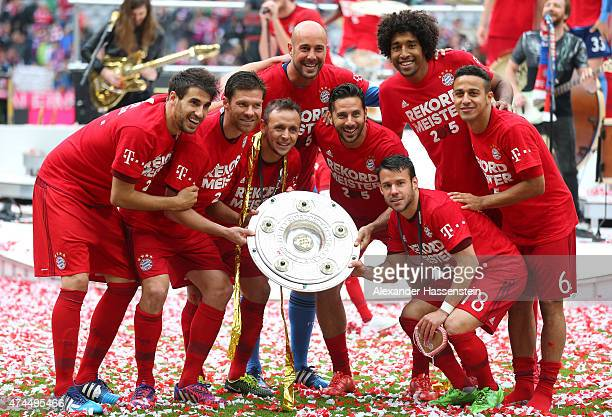 Bayern Muenchen players celebrate with the trophy after winning the league during the Bundesliga match between FC Bayern Muenchen and 1 FSV Mainz 05...
