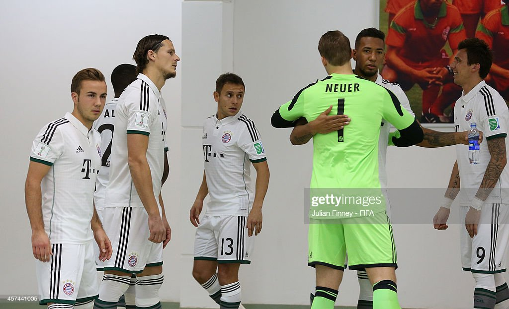 Bayern Muenchen players support each other before the FIFA Club World Cup Semi Final match between Guangzhou Evergrande FC and Bayern Muenchen at the Agadir Stadium on December 17, 2013 in Agadir, Morocco.