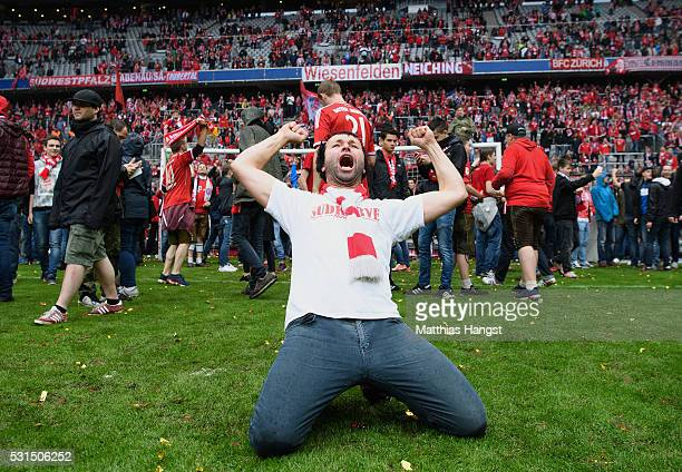 Bayern Muenchen supporter celebrates the Bundesliga champions after the Bundesliga match between FC Bayern Muenchen and Hannover 96 at Allianz Arena...
