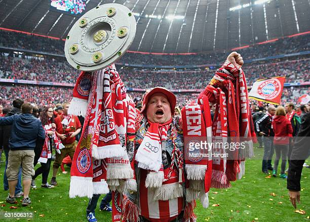 Bayern Muenchen supporters celebrate the Bundesliga champions after the Bundesliga match between FC Bayern Muenchen and Hannover 96 at Allianz Arena...