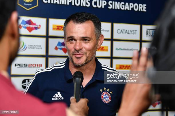 Bayern Muenchen team assistance manager Willy Sagnol smiles during the International Champions Cup match between Chelsea FC and FC Bayern Munich at...