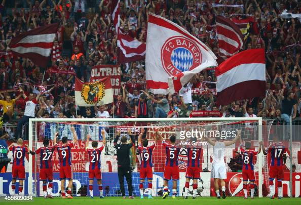 Bayern Munchen players celebrate victory with their fans after the UEFA Champions League Group E match between Bayern Munchen and Manchester City at...
