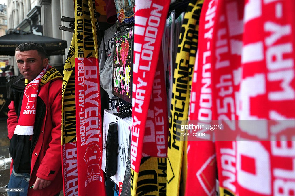 Bayern Munich and Borussia Dortmund scarves are displayed for sale in central London on May 24, 2013, a day ahead of the Champions League final between the two teams at Wembly stadium. AFP PHOTO/CARL COURT
