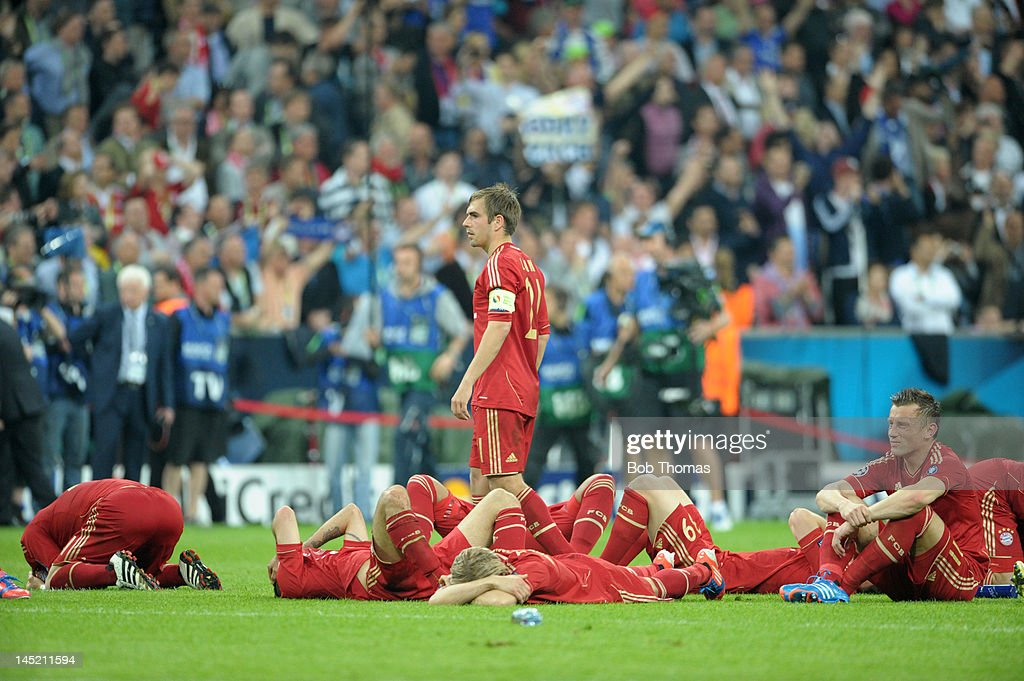 Bayern Munich captain <a gi-track='captionPersonalityLinkClicked' href=/galleries/search?phrase=Philipp+Lahm&family=editorial&specificpeople=483746 ng-click='$event.stopPropagation()'>Philipp Lahm</a> stands amongst his dejected team-mates after losing the UEFA Champions League Final between FC Bayern Munich and Chelsea at the Fussball Arena Munich on May 19, 2012 in Munich, Germany. The match ended 1-1 after extra time, Chelsea won 4-3 on penalties.