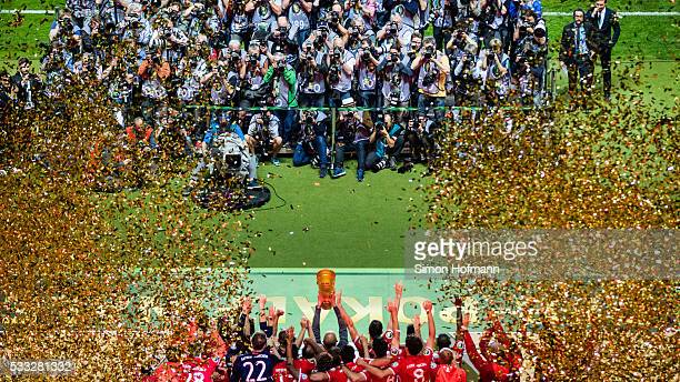 Bayern Munich celebrate with the trophy after the DFB Cup Final match between Bayern Muenchen and Borussia Dortmund at Olympiastadion on May 21 2016...