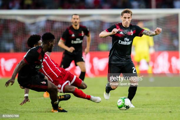 Bayern Munich Defender David Alaba trips up with AC Milan Defender Lucas Biglia during the 2017 International Champions Cup China match between FC...