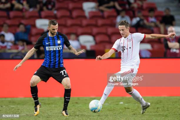 Bayern Munich Defender Marco Friedl plays against FC Internazionale Midfielder Marcelo Brozovic during the International Champions Cup match between...