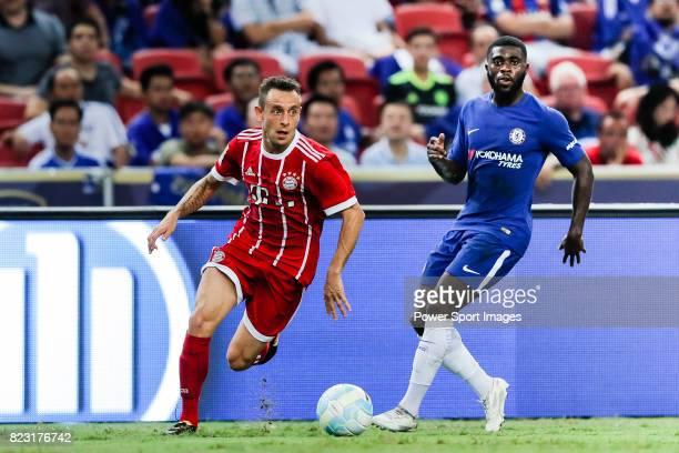 Bayern Munich Defender Rafinha de Souza plays against Chelsea Midfielder Jeremie Boga during the International Champions Cup match between Chelsea FC...