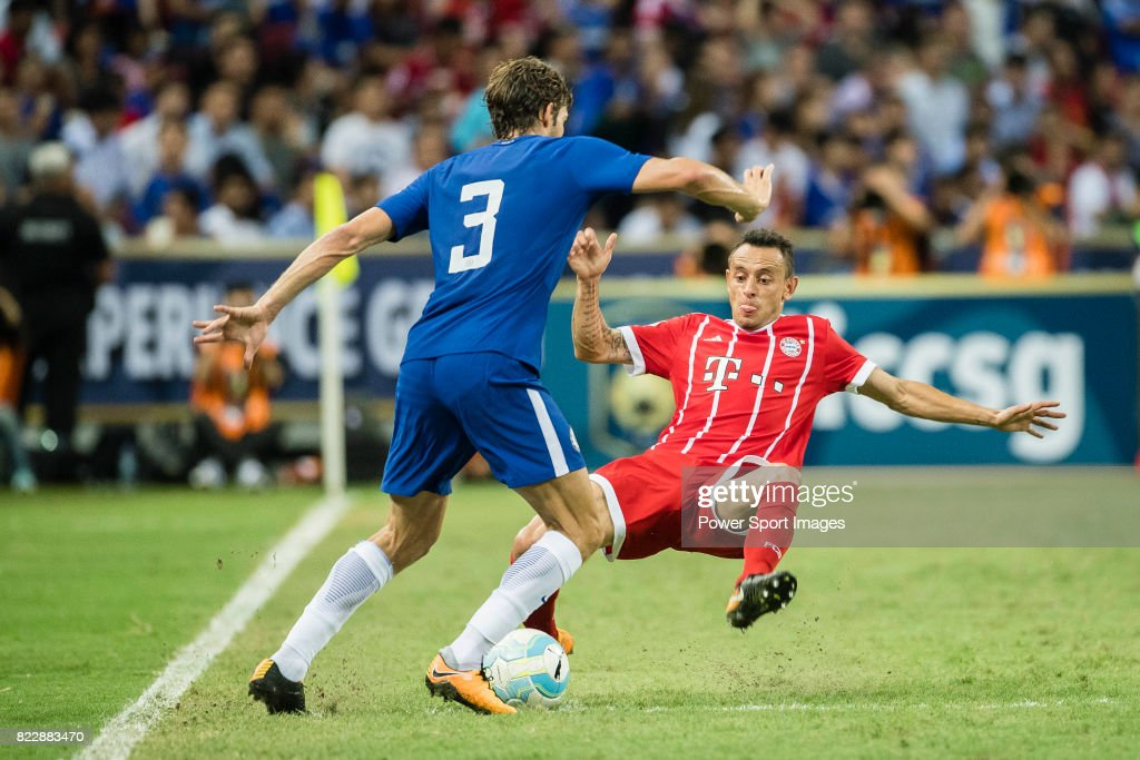 Bayern Munich Defender Rafinha de Souza (R) trips up with Chelsea Defender Marcos Alonso (L) during the International Champions Cup match between Chelsea FC and FC Bayern Munich at National Stadium on July 25, 2017 in Singapore.