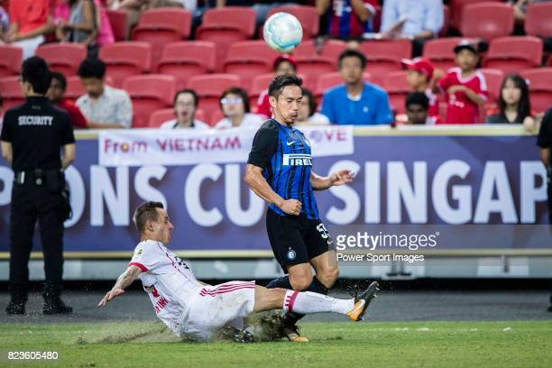 Bayern Munich Defender Rafinha de Souza trips up with FC Internazionale Defender Yuto Nagatomo during the International Champions Cup match between...