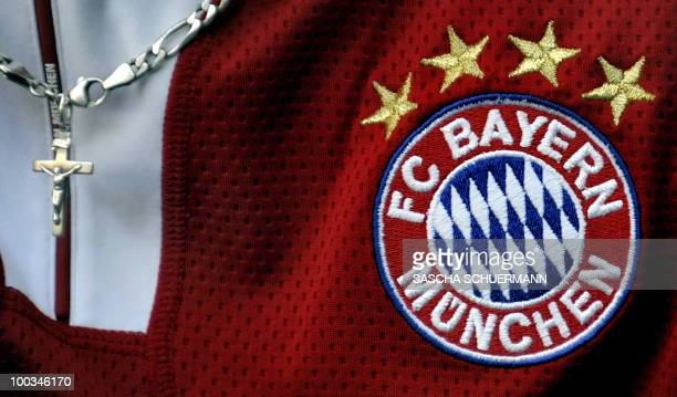 A Bayern Munich fan wears a cross on a chain at the Santiago Bernabeu stadium in Madrid on May 22 2010 before the UEFA Champions League Final against...
