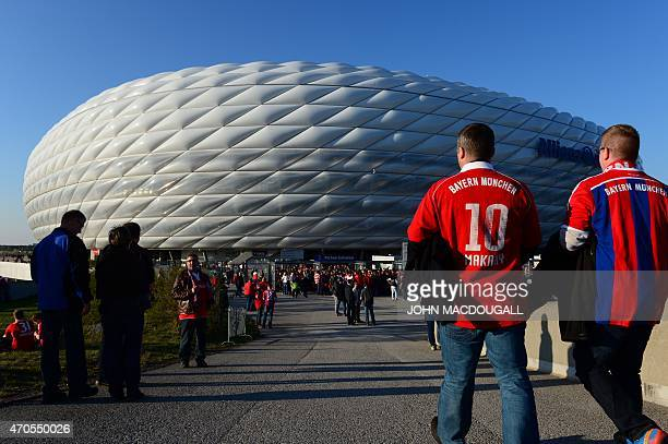 Bayern Munich fans arrive ahead of the UEFA Champions League secondleg quarterfinal football match Bayern Munich v FC Porto outside the Allianz Arena...