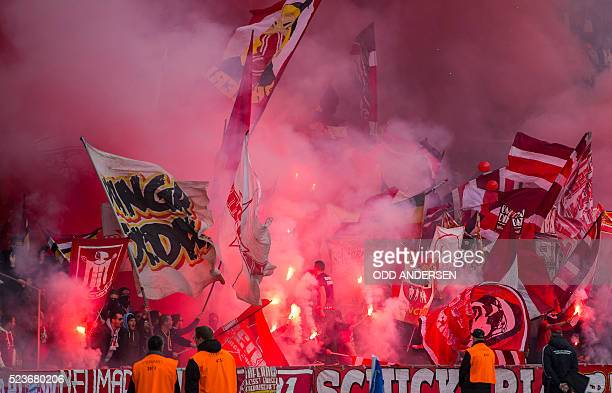 Bayern Munich fans burn flares during the German first division Bundesliga football match Hertha Berlin vs Bayern Munich at the Olympic stadium in...