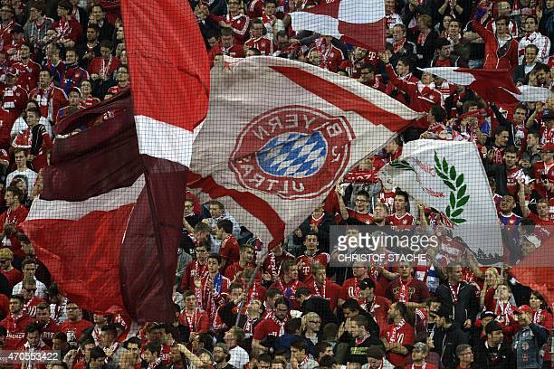 Bayern Munich fans cheer for their team during the UEFA Champions League secondleg quarterfinal football match Bayern Munich v FC Porto in Munich...