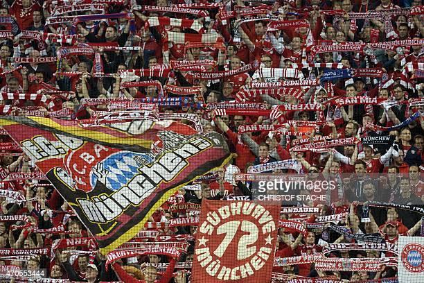 Bayern Munich fans cheer for their team during the UEFA Champions League secondleg quarterfinal football match Bayern Munich v FC Porto in Munich...