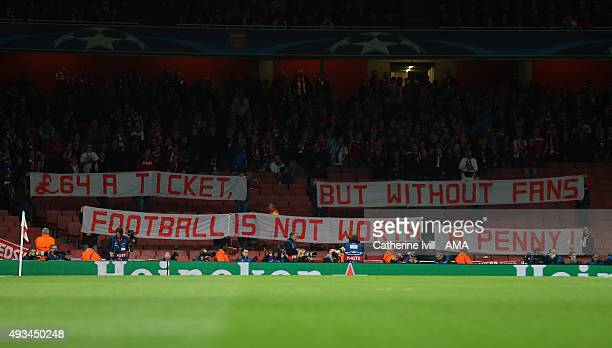 Bayern Munich fans display a banner protesting about the high price of tickets before they take their seats during the UEFA Champions League match...