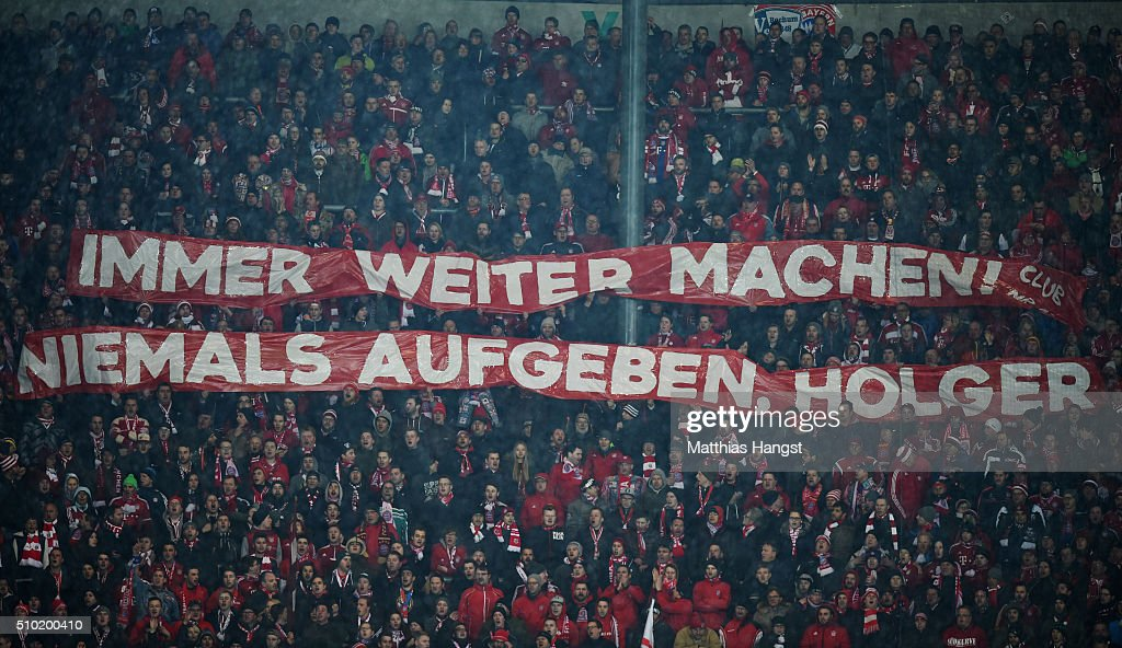 Bayern Munich fans display a banner showing support for injured player Holger Badstuber during the Bundesliga match between FC Augsburg and FC Bayern Muenchen at SGL Arena on February 14, 2016 in Augsburg, Germany.