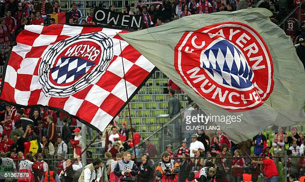 Bayern Munich fans fly their club's flag after they defeated Ajax Amsterdam during their Champions' League football match in Munich 28 September 2004...