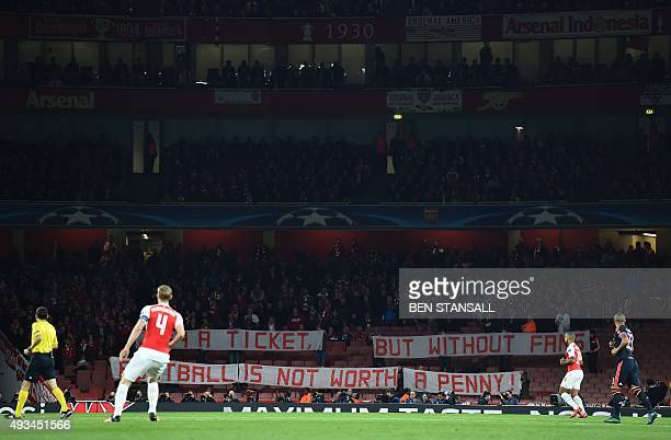 Bayern Munich fans hold a banner as they protest in the stands against the cost of tickets at the beginning of the UEFA Champions League football...