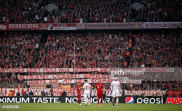 Bayern Munich fans hold a banner during the UEFA Champions League quarter final first leg match between FC Bayern Muenchen and SL Benfica at Allianz...