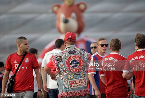 Bayern Munich fans make their way to the stadium ahead of the UEFA Champions League semi final second leg match between FC Bayern Muenchen and FC...