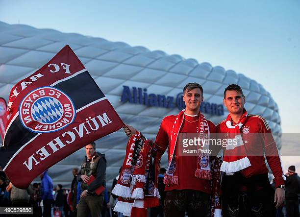 Bayern Munich fans pose for a picture outside the Allianz Arena before the UEFA Champions League match between FC Bayern Munchen and GNK Dinamo...