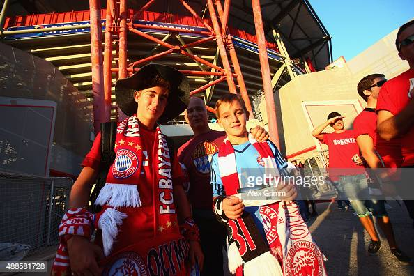 Bayern Munich fans pose outside the stadium prior to the UEFA Champions League Group F match between Olympiacos FC and FC Bayern Munchen at...