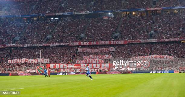 Bayern Munich fans show banners against the German football association during the German First division Bundesliga football match FC vs Bayer 04...