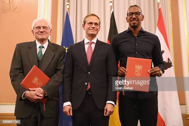 Bayern Munich football star Jerome Boateng and Peter von der OstenSacken pose with their awards with Berlin Mayor Michael Mueller at the 2016 Moses...