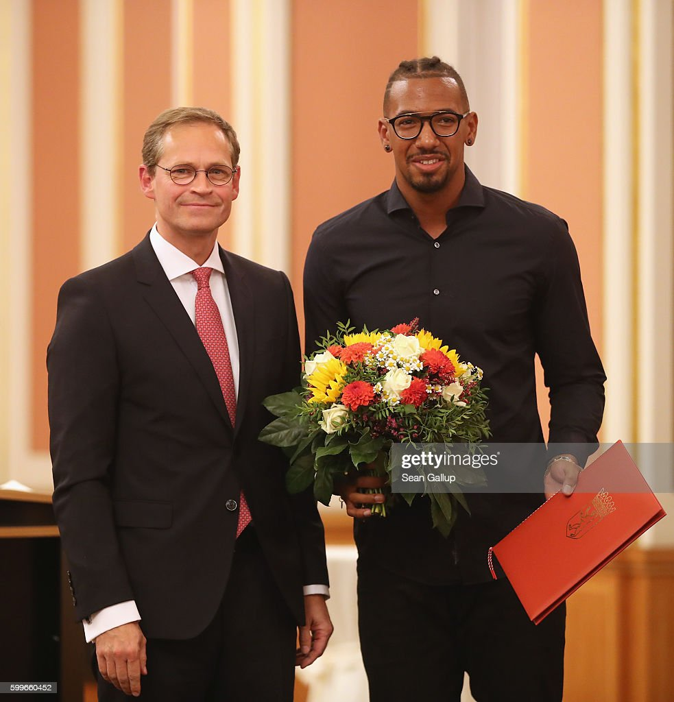 FC Bayern Munich football star Jerome Boateng poses with the 2016 Moses Mendelssohn Award after receiving it from Berlin Mayor Michael Mueller (L) on September 6, 2016 in Berlin, Germany. The award is in recognition of those who have furthered tolerance between peoples and religions in the city-state of Berlin.